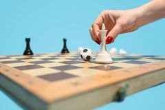 Soccer ball of chess pieces on the board. Football stratrgy. Soccer ball of chess pieces on the board. Game concept. Business ideas, competition, strategy and Royalty Free Stock Image