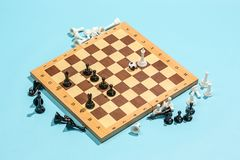 Soccer ball of chess pieces on the board. Game concept. Business ideas, competition, strategy and new ideas concept. Chess figures on blue background Royalty Free Stock Photography