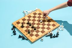 Soccer ball of chess pieces on the board. Game concept. Business ideas, competition, strategy and new ideas concept. Chess figures on blue background Stock Images