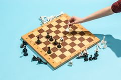 Soccer ball of chess pieces on the board. Game concept. Business ideas, competition, strategy and new ideas concept. Chess figures on blue background Stock Photos