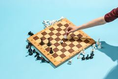 Soccer ball of chess pieces on the board. Game concept. Business ideas, competition, strategy and new ideas concept. Chess figures on blue background Royalty Free Stock Photo