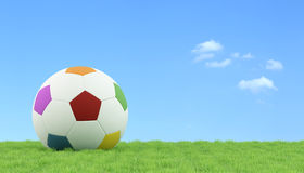 Soccer ball for children on grass. Colorful soccer ball for children on a lawn - 3D Rendering Royalty Free Stock Photo