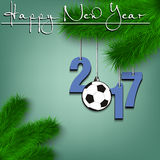 Soccer ball and 2017 on a Christmas tree branch. Happy New Year and numbers 2017 and soccer ball as a Christmas decorations hanging on a Christmas tree branch Stock Image