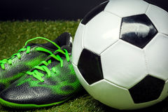 Soccer ball and cleats Stock Image