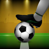 Soccer ball and cleats. On grass background Stock Photography
