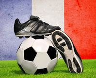 Soccer ball and cleats Royalty Free Stock Image
