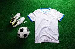 Soccer ball,cleats and white t-shirt against artificial turf Stock Images