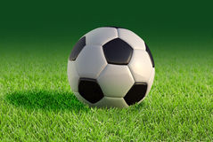 Soccer ball close up on grass lawn. Royalty Free Stock Photo