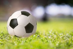 Soccer ball closeup on the field sport background. Soccer ball close up on the field sport background Royalty Free Stock Photography