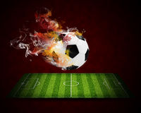 Soccer ball in the color of flame and smoke Stock Photography