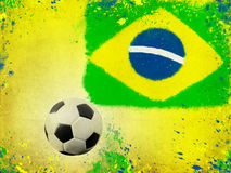 Soccer ball and the colors of Brazil flag Royalty Free Stock Image