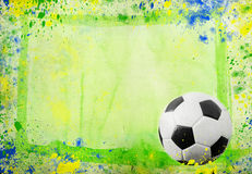 Soccer ball and the colors of Brazil flag Royalty Free Stock Photos
