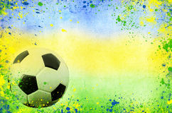 Soccer ball and the colors of Brazil flag Stock Photo