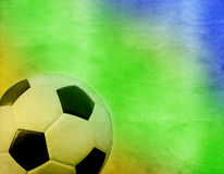 Soccer ball and the colors of Brazil flag Royalty Free Stock Photography