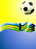 Soccer ball and the colors of Brazil flag Stock Images
