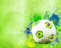 Soccer ball and the colors of Brazil flag Stock Image