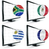 Soccer ball coming out of monitor Stock Photos