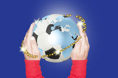 Soccer ball with continents painted on it and held with two hands Stock Images