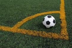 Soccer ball corner kick. Checkered soccer ball for a corner kick Royalty Free Stock Photos
