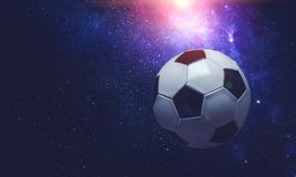 Soccer ball in cosmos. Soccer ball flying on the abstract space background stock photography