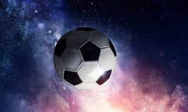 Soccer ball in cosmos. Soccer ball flying on the abstract space background stock image