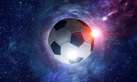 Soccer ball in cosmos. Soccer ball flying on the abstract space background royalty free stock photo