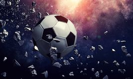 Soccer ball in cosmos. Soccer ball flying on the abstract space background royalty free stock images