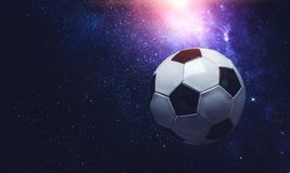 Soccer ball in cosmos. Soccer ball flying on the abstract space background stock photo