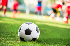 Soccer ball in court Royalty Free Stock Images