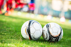 Soccer ball in court Royalty Free Stock Image