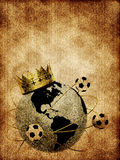 Soccer ball with crown and globe. On the old background Royalty Free Stock Photo