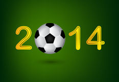 Soccer ball in 2014 digit on green background Royalty Free Stock Image