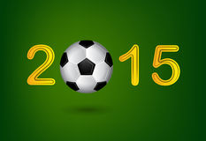 Soccer ball in 2015 digit on green background Royalty Free Stock Photos