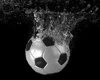 Soccer ball dives into water. Soccer ball falling into water. 3d illustration Stock Photo