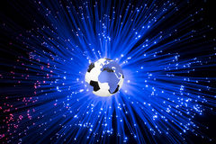 Soccer ball in earth globe on a background of blue Royalty Free Stock Photo