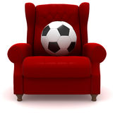 Soccer ball in easy chair Royalty Free Stock Image