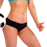 Soccer ball and feminine hips. Black Underwear. Close up photo o Royalty Free Stock Photography