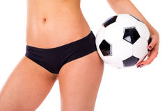 Soccer ball and feminine hips. Black Underwear. Close up photo o Stock Photography