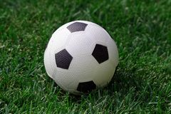 Soccer Ball on Field. Toy ball on grass royalty free stock photos