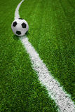 Soccer ball on field. Soccer ball on curve line green field Stock Photo