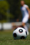 Soccer ball on field Royalty Free Stock Photos