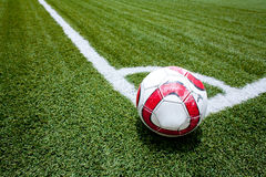 Soccer ball on the field corner Stock Photos