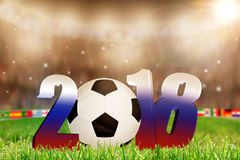 2018 Soccer Ball on Field Dressed in Russian Flag Colors. Low angle view of soccer ball on stadium field with Year 2018 dressed in Russian flag colors and Stock Photography