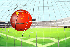 A soccer ball at the field with the flag of China Royalty Free Stock Photography