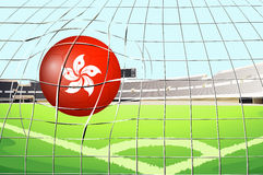 A soccer ball at the field with the flag of Hongkong Royalty Free Stock Photo