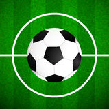 Soccer ball on field. Football background. Royalty Free Stock Image