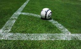 Soccer ball on the field Stock Photos