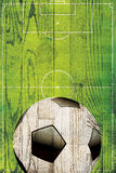Soccer Ball and Field Over Wood Stock Photography