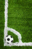 Soccer ball on the field. shooting a corner. Corner kick from top view Royalty Free Stock Images