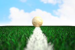 Soccer ball on field with sky background Stock Photos